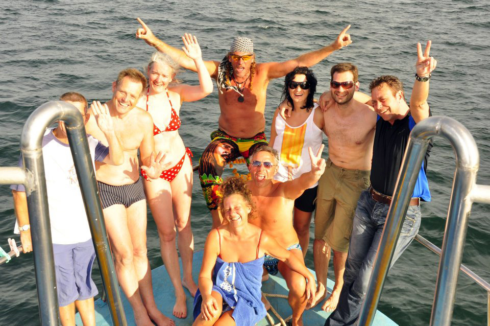 Group photo on the deck of our snorkeling liveaboard